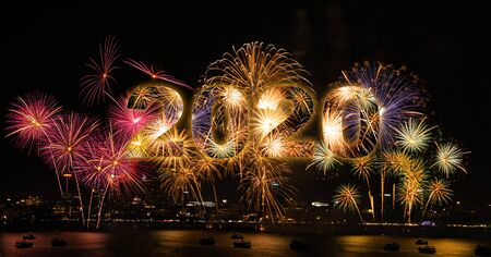 Photo for New year celebration fireworks with city in background of year 2020 - Royalty Free Image