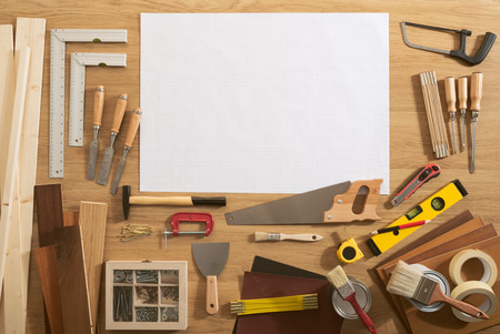 DIY blank project with copy space and construction tools all around on a work table, top view