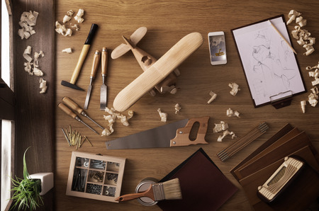 Photo pour DIY project at home concept, work table with handmade wooden toy airplane and carpentry work tools, top view - image libre de droit