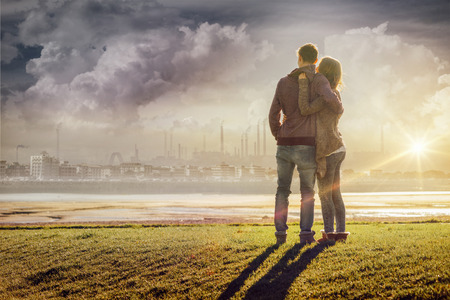 Photo pour Happy romantic loving couple at the lake hugging and looking away, love and relationships concept - image libre de droit