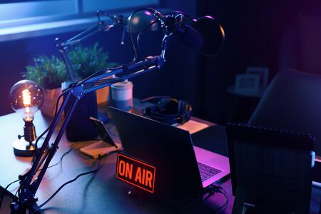 Photo for Live online radio broadcasting station desk with on air sign, entertainment and communication concept - Royalty Free Image