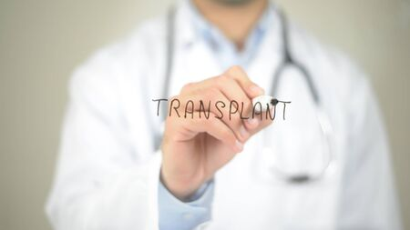 Transplant , Doctor writing on transparent screen