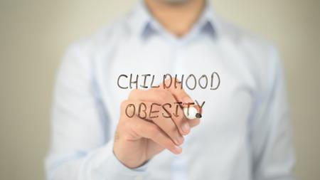 Childhood Obesity, man writing on transparent screen