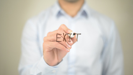 Exit,  Man writing on transparent screen