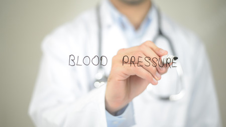 Blood Pressure , Doctor writing on transparent screen