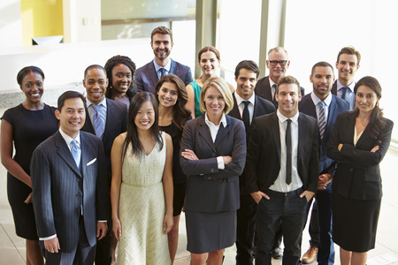 Portrait Of Multi-Cultural Office Staff Standing In Lobby