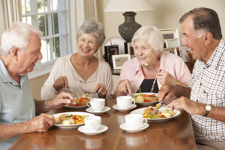 Group Of Senior Couples Enjoying Meal Together