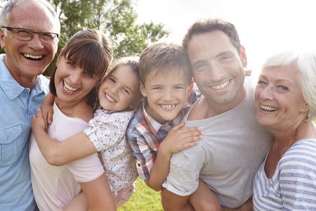 Multi Generation Family Giving Children Piggybacks Outdoors