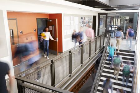 Photo for Busy High School Corridor During Recess With Blurred Students And Staff - Royalty Free Image