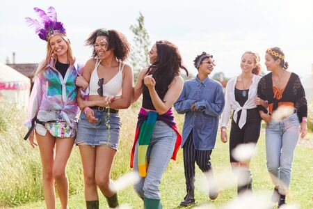 Photo for Female Friends Walking Back To Tent After Outdoor Music Festival - Royalty Free Image
