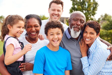 Photo for Portrait Of Smiling Multi-Generation Mixed Race Family In Garden At Home - Royalty Free Image