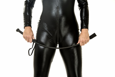 Fetish woman in latex holding a whip
