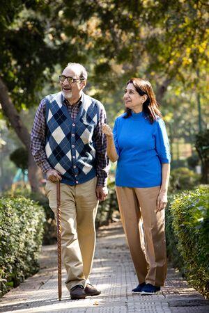 Photo pour Happy senior couple admiring view at park - image libre de droit