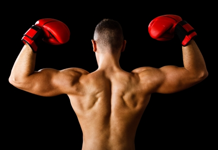 Boxer raising his arms in sign of victory