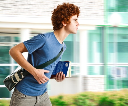 Portrait of a young man running to school