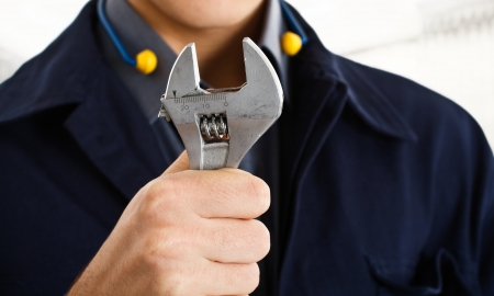 Worker holding an adjustable wrench