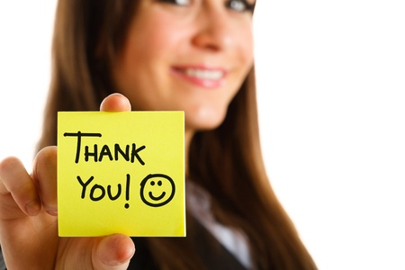 Business woman showing a post-it to thank you