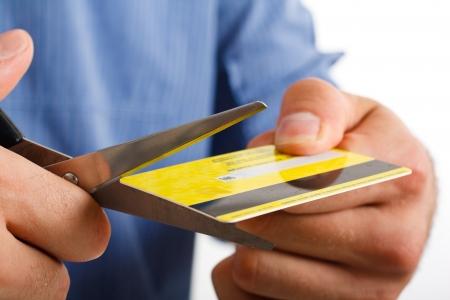 Man cutting up a credit card