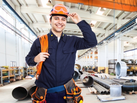 Photo for Portrait of an happy worker in a factory - Royalty Free Image