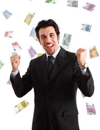 Happy man enjoying a rain of money