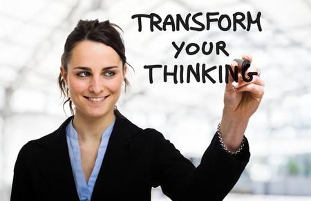 Foto de Businesswoman writing a motivational concept on the screen - Imagen libre de derechos