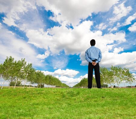 Businessman looking at a beautiful landscape