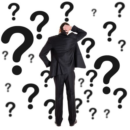 Thoughtful man surrounded by question marks