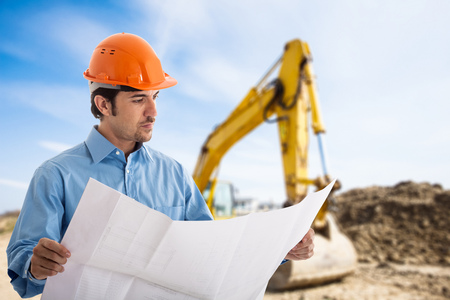 Portrait of an architect at work in a construction site