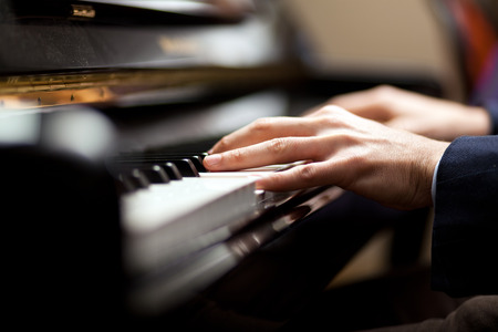 Close up of a musician playing a piano keyboard