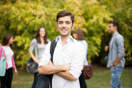 Outdoor portrait of a smiling young man