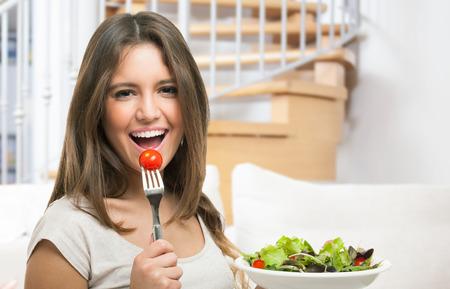 Photo pour Woman eating healthy food - image libre de droit