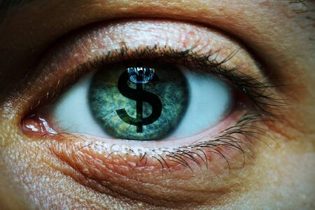 Close-up image of a man with a dollar symbol in his eye