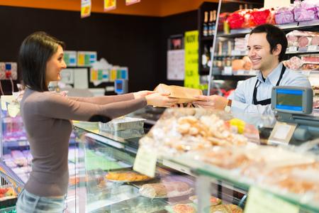 Foto für Shopkeeper working in his grocery store - Lizenzfreies Bild