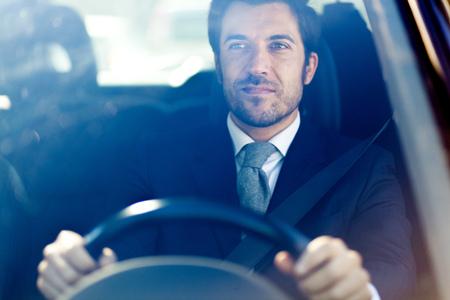 Photo pour Handsome man driving his car - image libre de droit