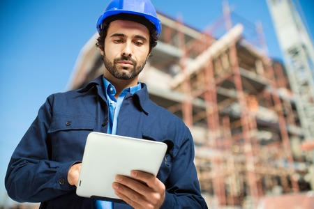 Photo for Construction specialist using a tablet computer - Royalty Free Image