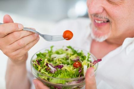Man eating a salad