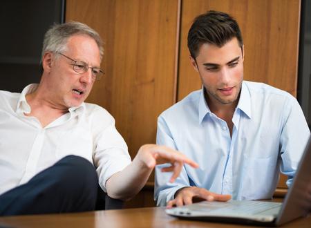 Foto für Business people wearing informal dresses at work in their office - Lizenzfreies Bild