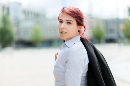 Photo pour Confident young female manager outdoor in a modern urban setting - image libre de droit