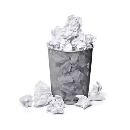 A trashcan full of crumpled paper