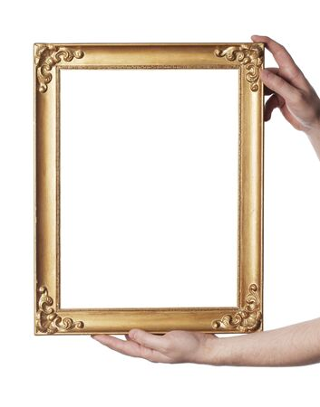 Man holding an old picture frame