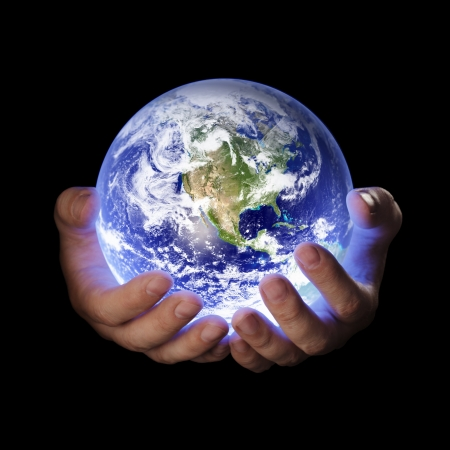 Foto de Man holding a glowing earth globe in his hands. Earth image provided by Nasa. - Imagen libre de derechos