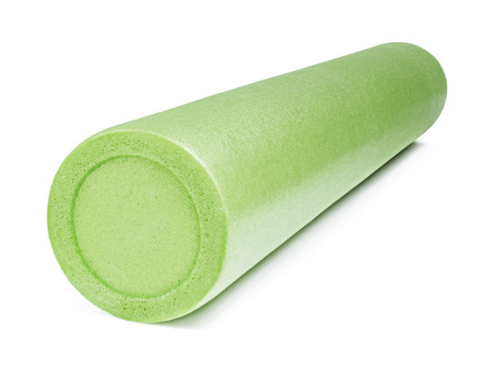 A green foam roller isolated on white