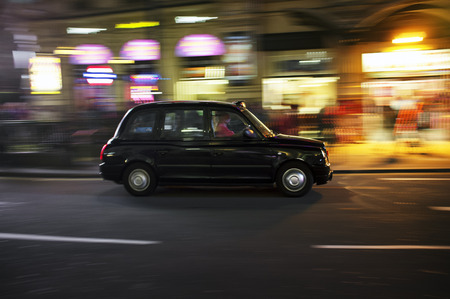 LONDON, UK – APRIL 16, 2014: Motorised hackney cabs in the UK, traditionally all black in London and most major cities, are traditionally known as black cabs