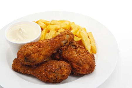 Three pieces of crispy southern fried chicken with fries