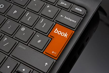 Book Return Key symbolizing the booking of a reservation at a hotel, restaurant or theatre