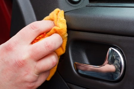 Cleaning the car interior with polishing cloth