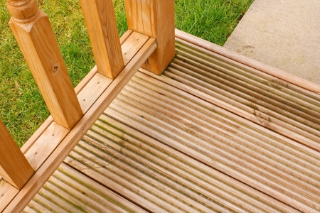 Corner profile of wooden garden decking a popular feature outside modern homes