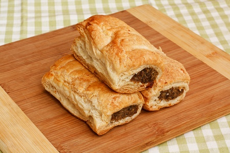 Freshly baked sausage rolls in a traditional setting a popular pastry snack available hot or cold from any English Bakery recently subject to the pasty tax for hot food