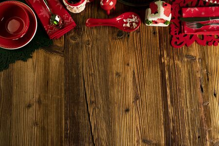 Photo pour Christmas background. Christmas tableware and decorations on rustic wooden table. - image libre de droit