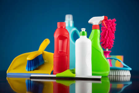 Photo for House and office cleaning theme. Colorful cleaning kit on blue background. - Royalty Free Image